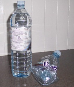 crushed water bottle to save recycling space