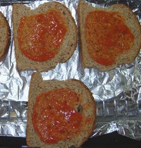 Spread bread with tomato puree