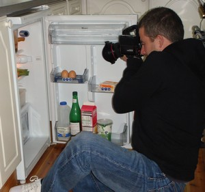 Who is this man photographing the contents of my 'fridge?