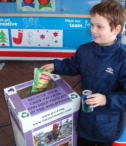 Josh recycles his empty crisp packet