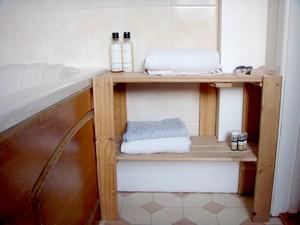 fron kitchen storage to bathroom