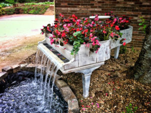 piano upcycled into a water fountain